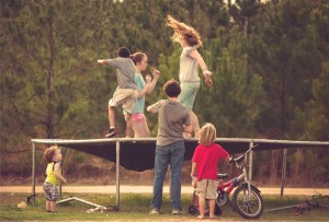 small people on trampoline